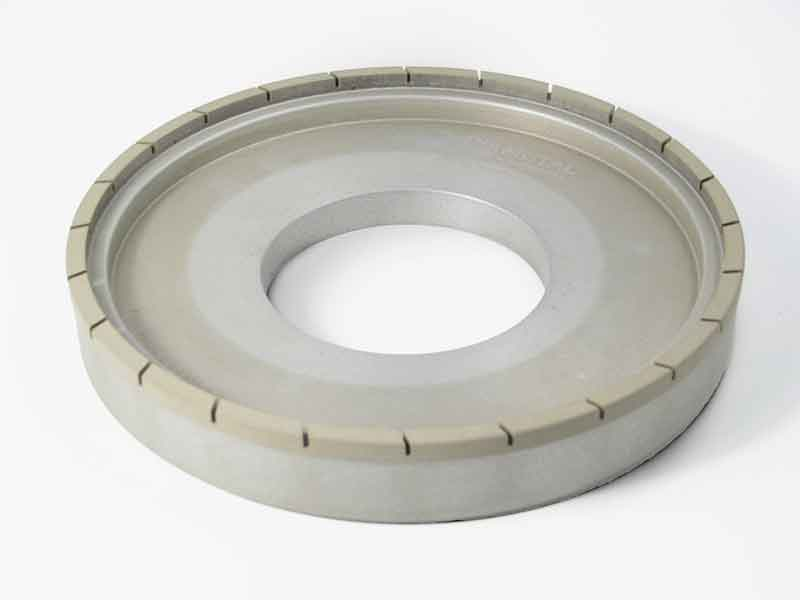 Segmented diamond grinding wheel from SCHELL with interrupted abrasive coating for substantial reduction of grinding forces and contact zone temperatures.